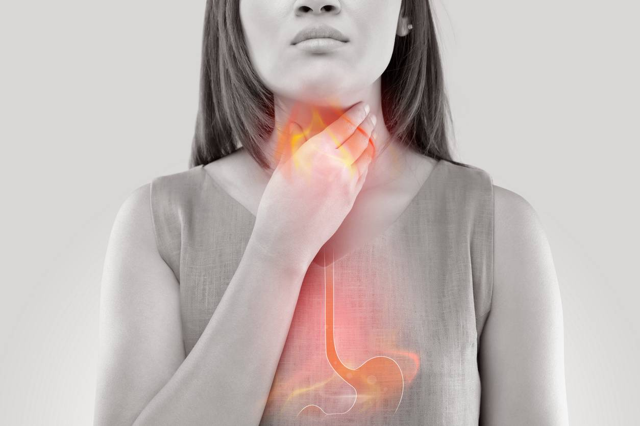 Woman Suffering From Acid Reflux Or Heartburn Isolated On White Background