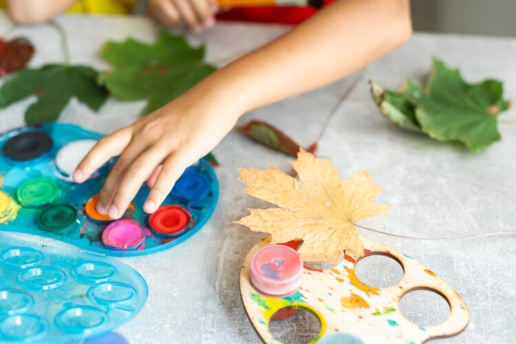 Children's,picture,made,from,autumn,leaves,paint